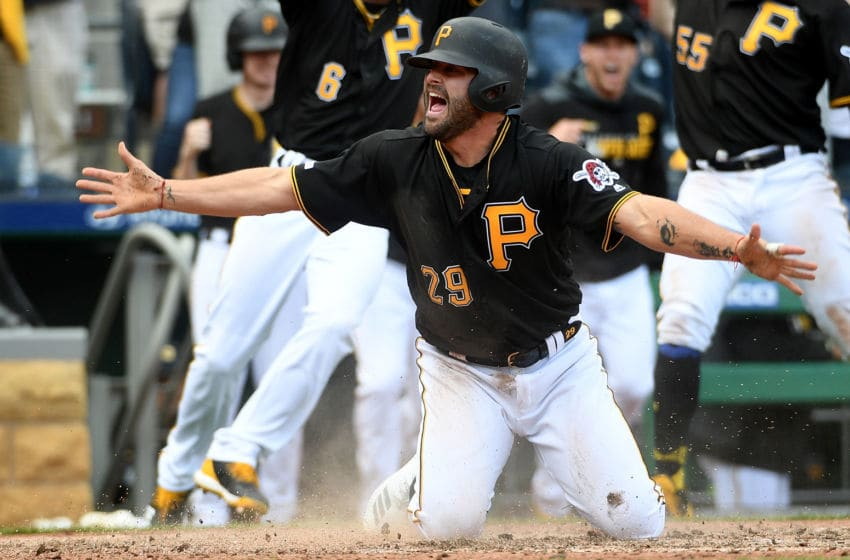 PITTSBURGH, PA - APRIL 06: Francisco Cervelli #29 of the Pittsburgh Pirates celebrates after scoring the winning run on a walk off double by Kevin Newman #27 in the 10th inning during the game against the Cincinnati Reds at PNC Park on April 6, 2019 in Pittsburgh, Pennsylvania. (Photo by Justin Berl/Getty Images)