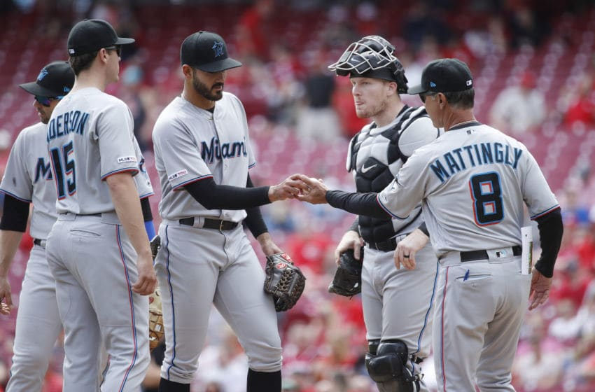 CINCINNATI, OH - APRIL 11: Pablo Lopez #49 of the Miami Marlins hands the ball to manager Don Mattingly after giving up three runs in the fifth inning against the Cincinnati Reds at Great American Ball Park on April 11, 2019 in Cincinnati, Ohio. The Reds won 5-0. (Photo by Joe Robbins/Getty Images)