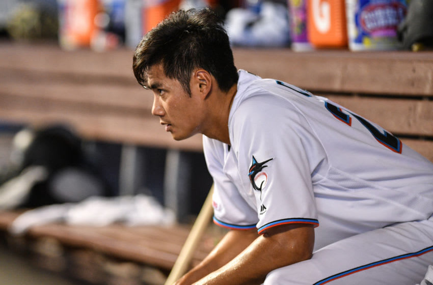 MIAMI, FL - APRIL 14: Wei-Yin Chen #20 of the Miami Marlins in the dugout after giving up a two run homerun to Jean Segura #2 of the Philadelphia Phillies in the fourteenth inning at Marlins Park on April 14, 2019 in Miami, Florida. (Photo by Mark Brown/Getty Images)