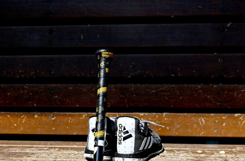 CINCINNATI, OHIO - MARCH 28: A pair of shoes and a bat sit in the Pittsburgh Pirates dugout on Opening Day between the Pittsburgh Pirates and the Cincinnati Reds at Great American Ball Park on March 28, 2019 in Cincinnati, Ohio. (Photo by Bobby Ellis/Getty Images)