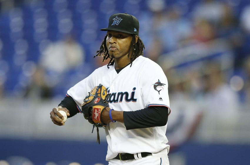 MIAMI, FLORIDA - APRIL 02: Jose Urena #62 of the Miami Marlins reacts after giving up a run in the first inning against the New York Mets at Marlins Park on April 02, 2019 in Miami, Florida. (Photo by Michael Reaves/Getty Images)