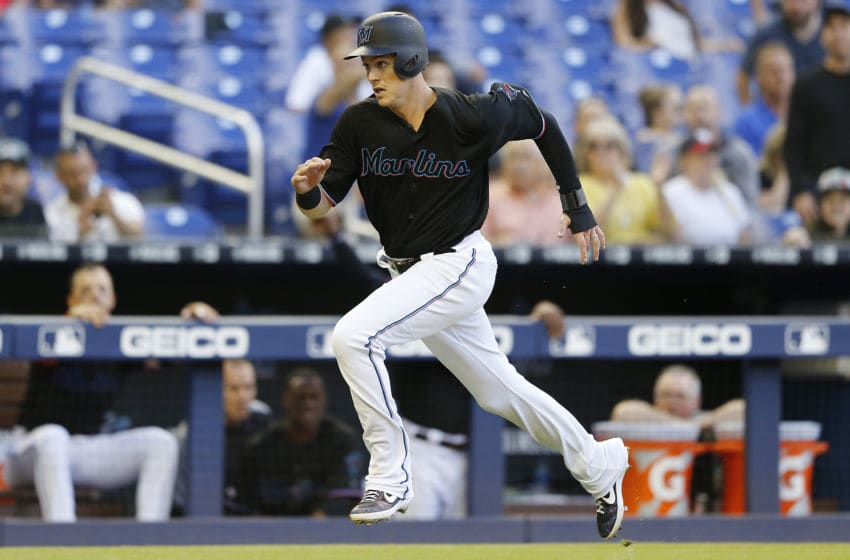 MIAMI, FLORIDA - APRIL 20: Brian Anderson #15 of the Miami Marlins runs home to score a run against the Washington Nationals at Marlins Park on April 20, 2019 in Miami, Florida. (Photo by Michael Reaves/Getty Images)