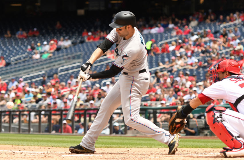 WASHINGTON, DC - MAY 27: Neil Walker #18 of the Miami Marlins singles in Garret Cooper #26 (not pictured) in the third inning during a baseball game against the Washington Nationals at Nationals Park on May 27, 2019 in Washington. DC. (Photo by Mitchell Layton/Getty Images)