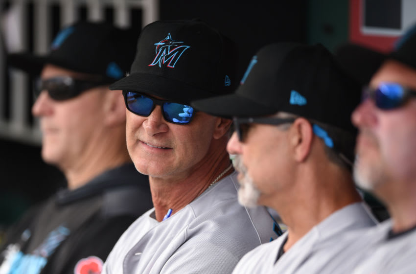 WASHINGTON, DC - MAY 27: Manager Don Mattingly #8 of the Miami Marlins looks on from the dug out during a baseball game against the Washington Nationals at Nationals Park on May 27, 2019 in Washington. DC. (Photo by Mitchell Layton/Getty Images)
