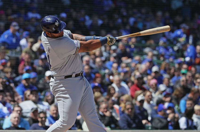 CHICAGO, ILLINOIS - MAY 10: Jesus Aguilar #24 of the Milwaukee Brewers bats against the Chicago Cubs at Wrigley Field on May 10, 2019 in Chicago, Illinois. (Photo by Jonathan Daniel/Getty Images)