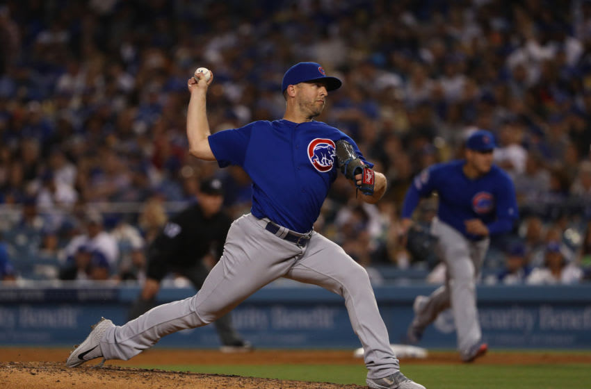 LOS ANGELES, CALIFORNIA - JUNE 15: Relief pitcher Brandon Kintzler #20 of the Chicago Cubs pitches in the eighth inning of the MLB game against the Los Angeles Dodgers at Dodger Stadium on June 15, 2019 in Los Angeles, California. The Cubs defeated the Dodgers 2-1. (Photo by Victor Decolongon/Getty Images)