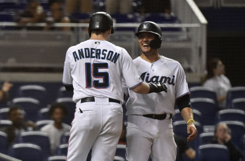 MIAMI, FL - JULY 31: Brian Anderson #15 of the Miami Marlins celebrates with Miguel Rojas #19 after hitting a grand slam in the ninth inning against the Minnesota Twins at Marlins Park on July 31, 2019 in Miami, Florida. (Photo by Eric Espada/Getty Images)