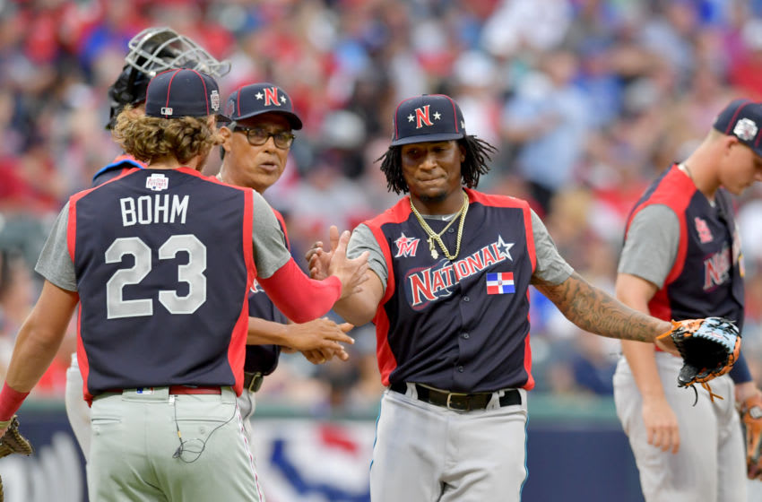 CLEVELAND, OHIO - JULY 07: Alec Bohm #23 celebrates with pitcher Sixto Sanchez #45 as Sanchez leaves the game during the fifth inning against the American League during the All-Stars Futures Game at Progressive Field on July 07, 2019 in Cleveland, Ohio. The American and National League teams tied 2-2. (Photo by Jason Miller/Getty Images)