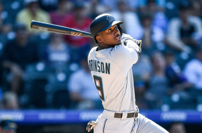DENVER, CO - AUGUST 18: Lewis Brinson #9 of the Miami Marlins hits a ninth inning double against the Colorado Rockies at Coors Field on August 18, 2019 in Denver, Colorado. (Photo by Dustin Bradford/Getty Images)