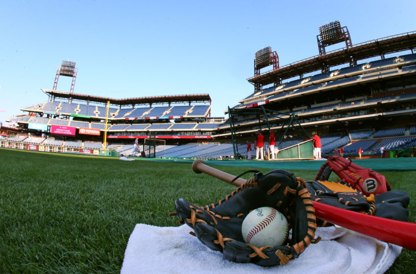 PHILADELPHIA, PA - SEPTEMBER 11: A bat glove and ball on the field before a game between the Atlanta Braves and Philadelphia Phillies at Citizens Bank Park on September 11, 2019 in Philadelphia, Pennsylvania. (Photo by Rich Schultz/Getty Images)