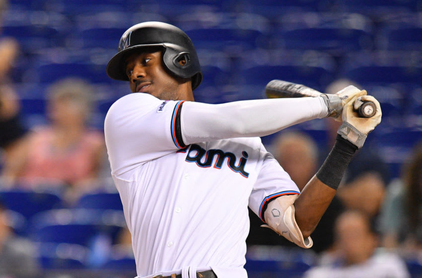 MIAMI, FL - SEPTEMBER 12: Lewis Brinson #9 of the Miami Marlins at bat against the Milwaukee Brewers at Marlins Park on September 12, 2019 in Miami, Florida. (Photo by Mark Brown/Getty Images)
