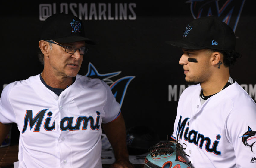 MIAMI, FL - SEPTEMBER 12: Don Mattingly #8 of the Miami Marlins speaking with Isan Diaz #1 before the game against the Milwaukee Brewers at Marlins Park on September 12, 2019 in Miami, Florida. (Photo by Mark Brown/Getty Images)