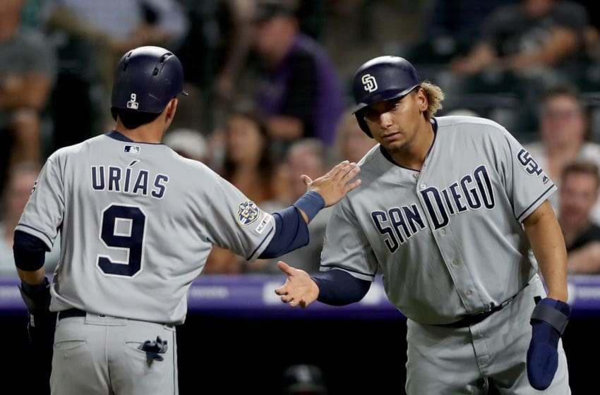 DENVER, COLORADO - SEPTEMBER 13: Luis Urias #9 of the San Diego Padres celebrates with Josh Naylor #22 after both scoring on a Ty France single in the sixth inning against the Colorado Rockies at Coors Field on September 13, 2019 in Denver, Colorado. (Photo by Matthew Stockman/Getty Images)