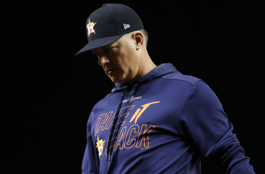 WASHINGTON, DC - OCTOBER 27: AJ Hinch #14 of the Houston Astros returns to the dugout after a mound visit against the Washington Nationals during the seventh inning in Game Five of the 2019 World Series at Nationals Park on October 27, 2019 in Washington, DC. (Photo by Patrick Smith/Getty Images)