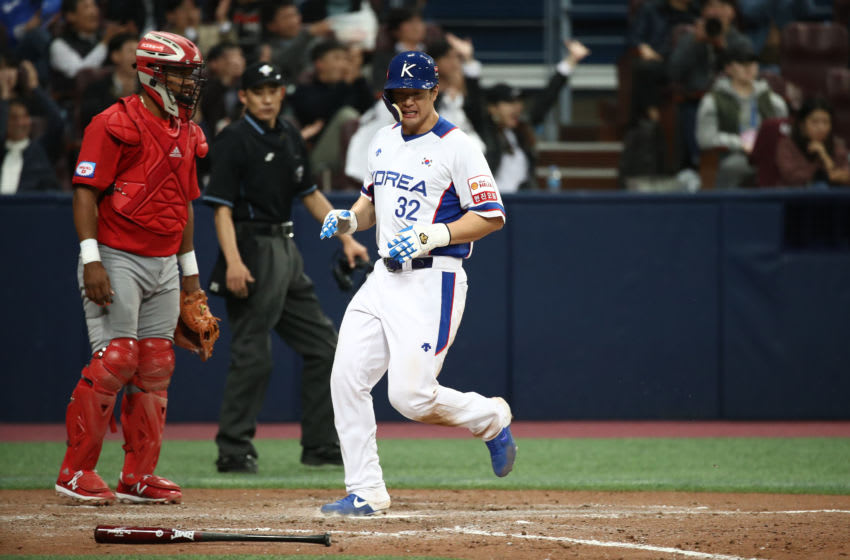 SEOUL, SOUTH KOREA - NOVEMBER 08: Outfielder Kim Jae-hwan #32 of South Korea reacts as he crosses the plate to score in the bottom of fifth inning during the WBSC Premier 12 Opening Round Group C game between South Korea and Cuba at the Gocheok Sky Dome on November 08, 2019 in Seoul, South Korea. (Photo by Chung Sung-Jun/Getty Images)