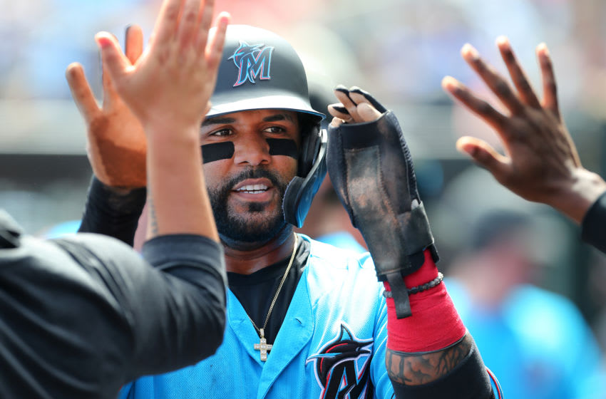 JUPITER, FL - MARCH 10: Jonathan Villar #2 of the Miami Marlins is congratulated by teammates after scoring on a double by Brian Anderson #15 during the third inning of a spring training baseball game against the Washington Nationals at Roger Dean Stadium on March 10, 2020 in Jupiter, Florida. The Marlins defeated the Nationals 3-2. (Photo by Rich Schultz/Getty Images)