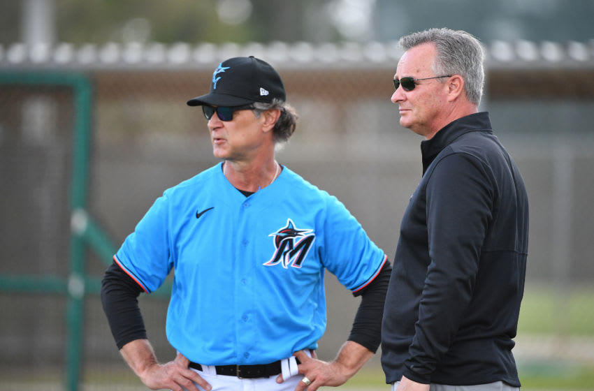 JUPITER, FLORIDA - FEBRUARY 19: Don Mattingly #8 of the Miami Marlins and Gary Denbo speak prior to the team performing drills during team workouts at Roger Dean Chevrolet Stadium on February 19, 2020 in Jupiter, Florida. (Photo by Mark Brown/Getty Images)
