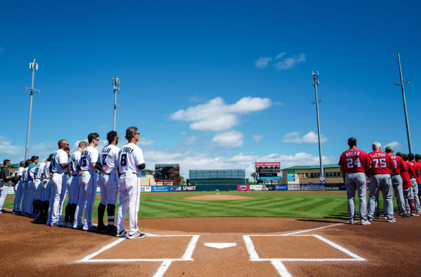 JUPITER, FLORIDA - FEBRUARY 23: The Miami Marlins and the Washington Nationals line up for the National Anthem prior to the spring training game at Roger Dean Chevrolet Stadium on February 23, 2020 in Jupiter, Florida. (Photo by Mark Brown/Getty Images)