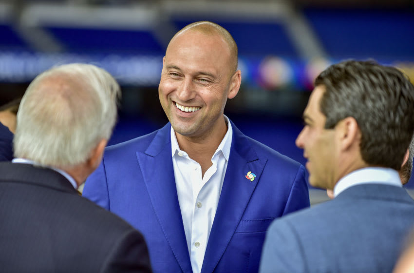 MIAMI, FLORIDA - FEBRUARY 25: CEO Derek Jeter of the Miami Marlins talks to Carlos A. Gimenez and Francis X. Suarez before the press conference to announce the World Baseball Classic will be held in Miami next year on February 25, 2020 in Miami, Florida. (Photo by Eric Espada/Getty Images)