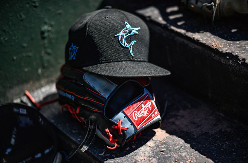 SARASOTA, FLORIDA - FEBRUARY 29: A detailed view of the Miami Marlins New Era cap resting on a Rawlings baseball glove of Monte Harrison #60 of the Miami Marlins during the spring training game against the Baltimore Orioles at Ed Smith Stadium on February 29, 2020 in Sarasota, Florida. (Photo by Mark Brown/Getty Images)