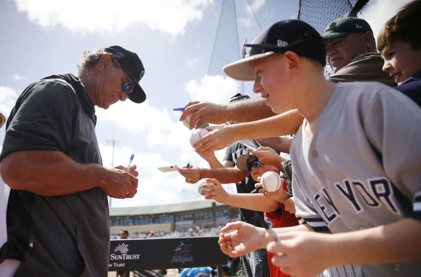 JUPITER, FLORIDA - MARCH 11: Manager Don Mattingly #8 of the Miami Marlins signs a autograph for a fan prior to a Grapefruit League spring training against the New York Yankees at Roger Dean Stadium on March 11, 2020 in Jupiter, Florida. (Photo by Michael Reaves/Getty Images)