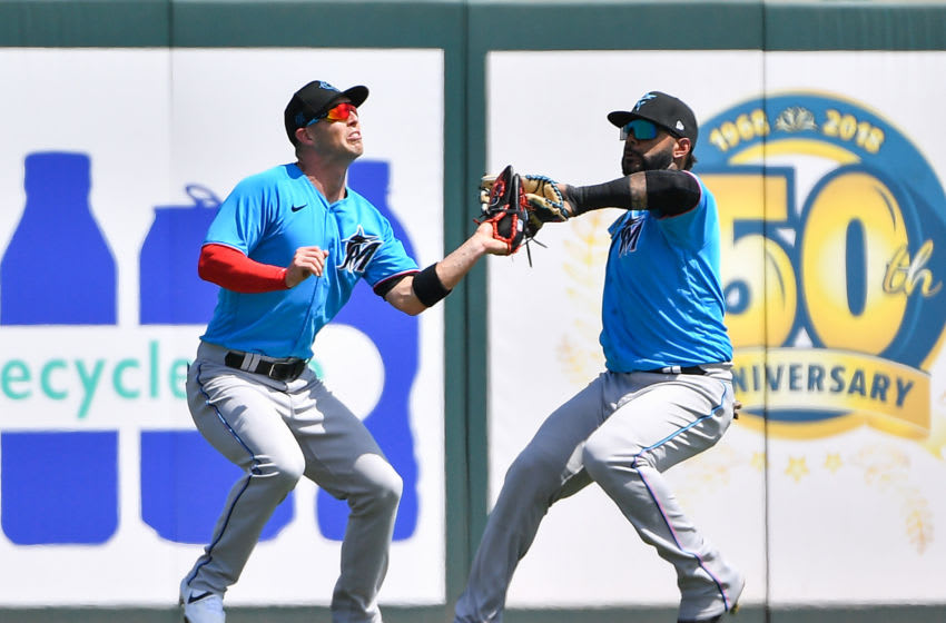 JUPITER, FLORIDA - MARCH 12: Corey Dickerson #23 and Jonathan Villar #2 of the Miami Marlins attempt to catch the ball in the second inning during the spring training game against the St. Louis Cardinals at Roger Dean Chevrolet Stadium on March 12, 2020 in Jupiter, Florida. Major League Baseball is suspending Spring Training and delaying the start of the regular season by at least two weeks due to the ongoing threat of the Coronavirus (COVID-19) outbreak. (Photo by Mark Brown/Getty Images)