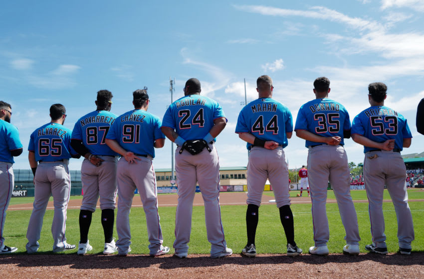 JUPITER, FLORIDA - MARCH 12: Miami Marlins stand during the National Anthem before the spring training game against the St. Louis Cardinals at Roger Dean Chevrolet Stadium on March 12, 2020 in Jupiter, Florida. Major League Baseball is suspending Spring Training and delaying the start of the regular season by at least two weeks due to the ongoing threat of the Coronavirus (COVID-19) outbreak. (Photo by Mark Brown/Getty Images)