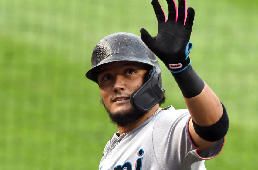 WASHINGTON, DC - AUGUST 21: Miguel Rojas 19 of the Miami Marlins celebrates a three run home run in the second inning during a baseball game against the Washington Nationals at Nationals Park on August 21, 2020 in Washington, DC. (Photo by Mitchell Layton/Getty Images)