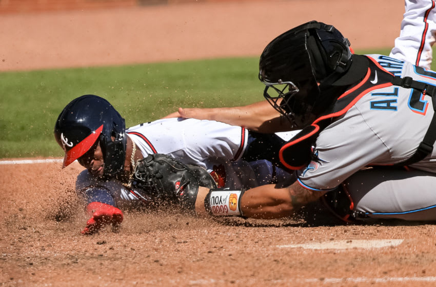 ATLANTA, GEORGIA - SEPTEMBER 07: Adeiny Hechavarria #24 of the Atlanta Braves is tagged out at home by Jorge Alfaro #38 of the Miami Marlins in the seventh inning at Truist Park on September 7, 2020 in Atlanta, Georgia. (Photo by Carmen Mandato/Getty Images)