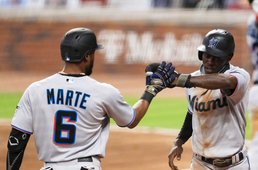 ATLANTA, GEORGIA - SEPTEMBER 08: Jazz Chisholm #70 of the Miami Marlins high fives Starling Marte #6 after scoring during the fourth inning of a game against the Atlanta Braves at Truist Park on September 8, 2020 in Atlanta, Georgia. (Photo by Carmen Mandato/Getty Images)