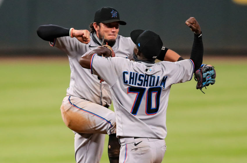 ATLANTA, GEORGIA - SEPTEMBER 08: Jazz Chisholm #70 of the Miami Marlins and Miguel Rojas #19 celebrate defeating the Atlanta Braves 8-0 at Truist Park on September 8, 2020 in Atlanta, Georgia. (Photo by Carmen Mandato/Getty Images)