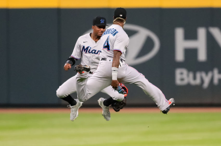 ATLANTA, GEORGIA - SEPTEMBER 08: Lewis Brinson #25 of the Miami Marlins and Monte Harrison #4 celebrate defeating the Atlanta Braves 8-0 at Truist Park on September 8, 2020 in Atlanta, Georgia. (Photo by Carmen Mandato/Getty Images)
