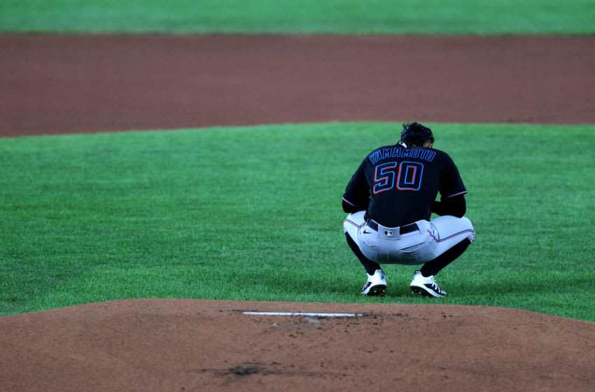 BALTIMORE, MARYLAND - AUGUST 06: Starting pitcher Jordan Yamamoto #50 of the Miami Marlins waits to pitch against the Baltimore Orioles batter in the first inning at Oriole Park at Camden Yards on August 06, 2020 in Baltimore, Maryland. (Photo by Rob Carr/Getty Images)