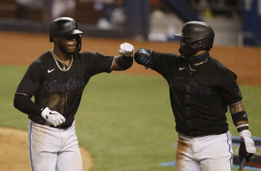 MIAMI, FLORIDA - AUGUST 15: Monte Harrison #4 of the Miami Marlins celebrates with Jonathan Villar #2 after hitting his first career home run against the Atlanta Braves during the eighth inning at Marlins Park on August 15, 2020 in Miami, Florida. (Photo by Michael Reaves/Getty Images)