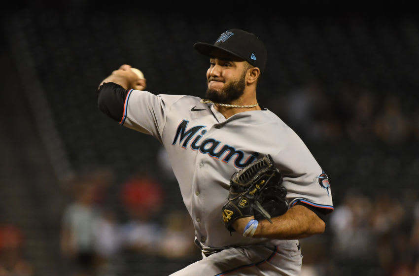 PHOENIX, ARIZONA - MAY 12: Yimi Garcia #93 of the the Miami Marlins delivers a pitch against the Arizona Diamondbacks at Chase Field on May 12, 2021 in Phoenix, Arizona. (Photo by Norm Hall/Getty Images)