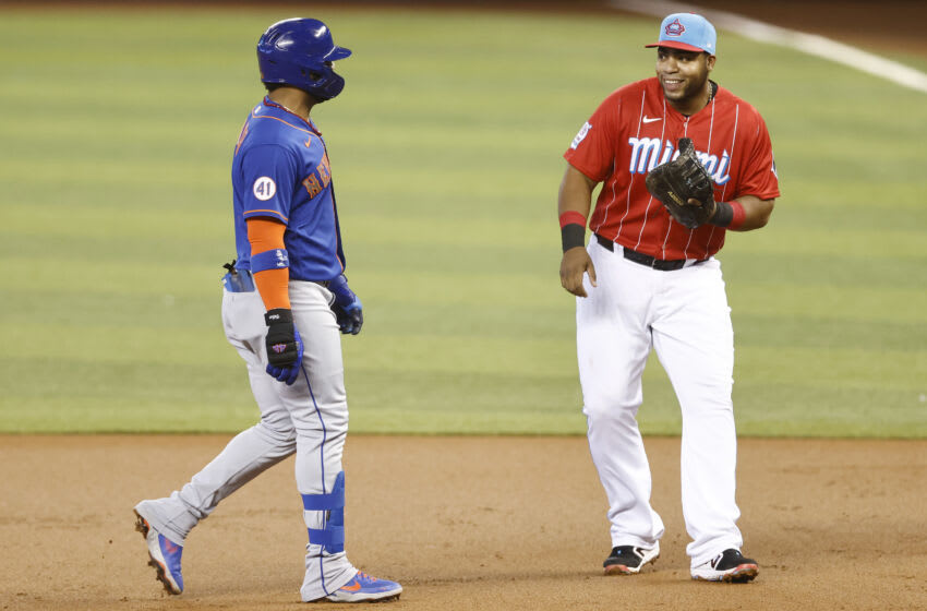 MIAMI, FLORIDA - MAY 23: Jonathan Villar #1 of the New York Mets laughs with Jesus Aguilar #24 of the Miami Marlins at loanDepot park on May 23, 2021 in Miami, Florida. (Photo by Michael Reaves/Getty Images)