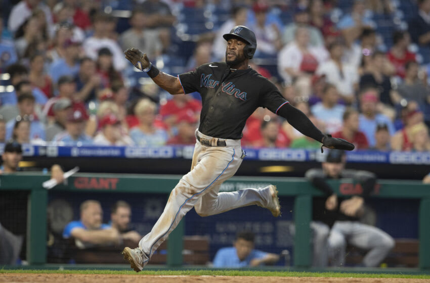 PHILADELPHIA, PA - JULY 16: Starling Marte #6 of the Miami Marlins slides home safely to score a run in the top of the third inning against the Philadelphia Phillies during Game Two of the doubleheader at Citizens Bank Park on July 16, 2021 in Philadelphia, Pennsylvania (Photo by Mitchell Leff/Getty Images)