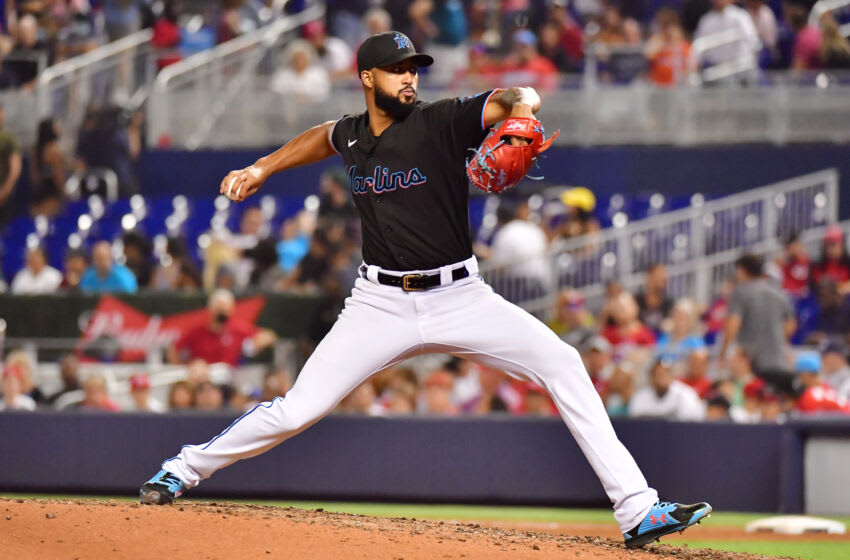 MIAMI, FLORIDA - AUGUST 28: Sandy Alcantara #22 of the Miami Marlins delivers a pitch to the Cincinnati Reds in the sixth inning at loanDepot park on August 28, 2021 in Miami, Florida. (Photo by Julio Aguilar/Getty Images)