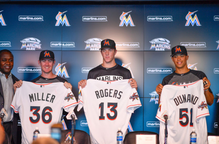 MIAMI, FL - JUNE 23: (L-R) The Miami Marlins top three draft picks Brian Miller, Trevor Rogers, and Joe Dunand visit Marlins Park for a press conference before the game between the Miami Marlins and the Chicago Cubs at Marlins Park on June 23, 2017 in Miami, Florida. (Photo by Mark Brown/Getty Images)