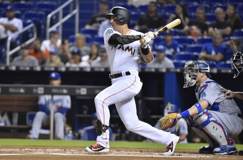 MIAMI, FL - MAY 16: Martin Prado #14 of the Miami Marlins singles in the first inning of the game against the Los Angeles Dodgers at Marlins Park on May 16, 2018 in Miami, Florida. (Photo by Eric Espada/Getty Images)