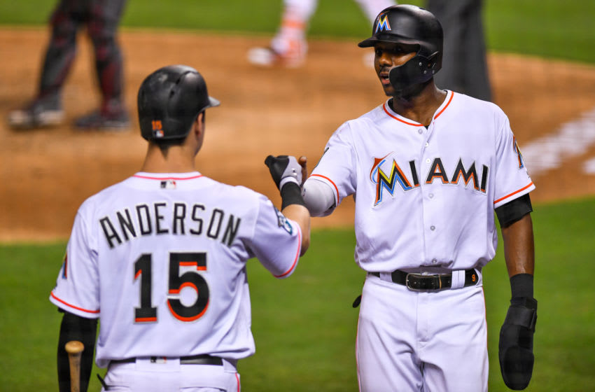 MIAMI, FL - JUNE 25: Lewis Brinson #9 of the Miami Marlins and Brian Anderson #15 high five at home plate after scoring in the eighth inning during the game against the Arizona Diamondbacks at Marlins Park on June 25, 2018 in Miami, Florida. (Photo by Mark Brown/Getty Images)