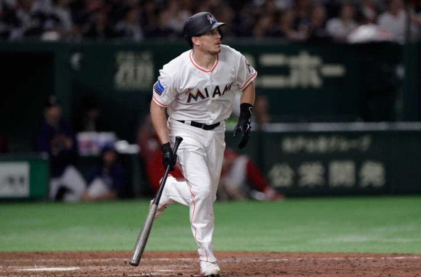 TOKYO, JAPAN - NOVEMBER 10: Catcher J.T. Realmuto #11 of the Miami Marlins hits a three-run home run in the bottom of 8th inning during the game two of the Japan and MLB All Stars at Tokyo Dome on November 10, 2018 in Tokyo, Japan. (Photo by Kiyoshi Ota/Getty Images)