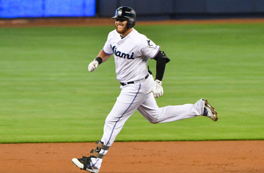 MIAMI, FL - JUNE 09: Austin Dean #44 of the Miami Marlins rounds the bases after hitting a home run in the first inning against the Atlanta Braves at Marlins Park on June 9, 2019 in Miami, Florida. (Photo by Mark Brown/Getty Images)