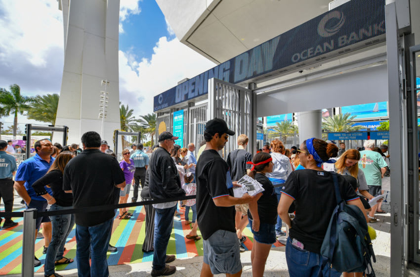 MIAMI, FL - MARCH 28: Fans enter the ballpark before the game between the Miami Marlins and the Colorado Rockies during Opening Day at Marlins Park on March 28, 2019 in Miami, Florida. (Photo by Mark Brown/Getty Images)