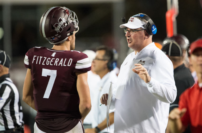 STARKVILLE, MS - SEPTEMBER 15: Head coach Joe Moorhead of the Mississippi State Bulldogs speaks with quarterback Nick Fitzgerald #7 of the Mississippi State Bulldogs during the third quarter of their game against the Louisiana-Lafayette Ragin Cajuns on September 15, 2018 at Davis Wade Stadium in Starkville, Mississippi. (Photo by Michael Chang/Getty Images)