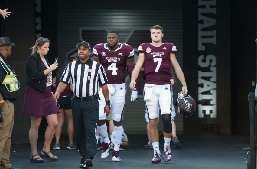STARKVILLE, MS - SEPTEMBER 15: Quarterback Nick Fitzgerald #7 of the Mississippi State Bulldogs and defensive end Gerri Green #4 of the Mississippi State Bulldogs walk out of the tunnel prior to their game against the Louisiana-Lafayette Ragin Cajuns on September 15, 2018 at Davis Wade Stadium in Starkville, Mississippi. (Photo by Michael Chang/Getty Images)