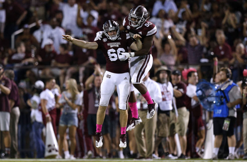 STARKVILLE, MS - OCTOBER 06: Joel Baldwin #66 of the Mississippi State Bulldogs and Tim Washington #50 celebrate a recovered fumble during the first half against the Auburn Tigers at Davis Wade Stadium on October 6, 2018 in Starkville, Mississippi. (Photo by Jonathan Bachman/Getty Images)