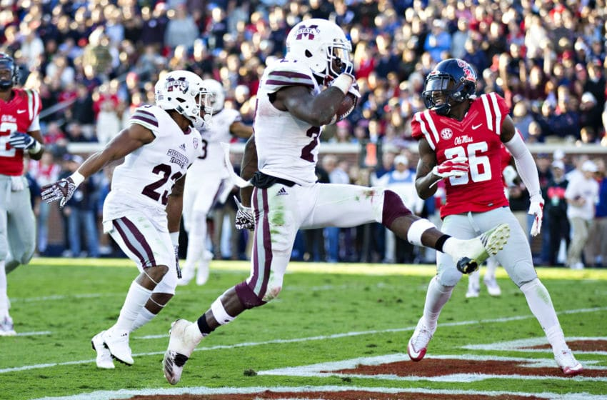OXFORD, MS - NOVEMBER 26: Aeris Williams #27 of the Mississippi State Bulldogs high steps into the end zone for a touchdown in the first half of a game against the Mississippi Rebels at Vaught-Hemingway Stadium on November 26, 2016 in Oxford, Mississippi. (Photo by Wesley Hitt/Getty Images)