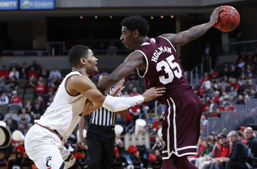 HIGHLAND HEIGHTS, KY - DECEMBER 12: Kyle Washington #24 of the Cincinnati Bearcats defends against Aric Holman #35 of the Mississippi State Bulldogs in the second half of a game at BB&T Arena on December 12, 2017 in Highland Heights, Kentucky. Cincinnati won 65-50. (Photo by Joe Robbins/Getty Images)