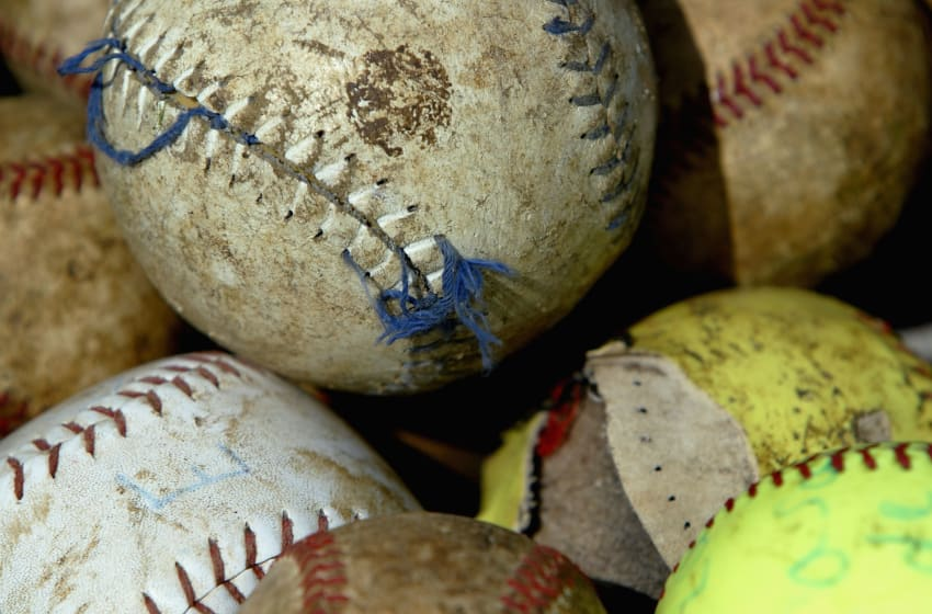 CONSUELO, DOMINICAN REPUBLIC - AUGUST 20: A Close up of tattered baseballs and softballs the players use to practice with on August 20, 2003 in Consuelo, Dominican Republic. Consuelo, which has ten programs for youths to learn and play baseball, is about 50 miles east of Santo Domingo. Of the ten programs, two provide housing for the players. One of which is Latin Baseball Academy, which was set up ten months ago by Luis Silvestre, a taxi driver in the Bronx, New York. (Photo by Ezra Shaw/Getty Images)
